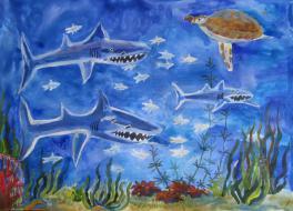 Семья акул на морском дне
